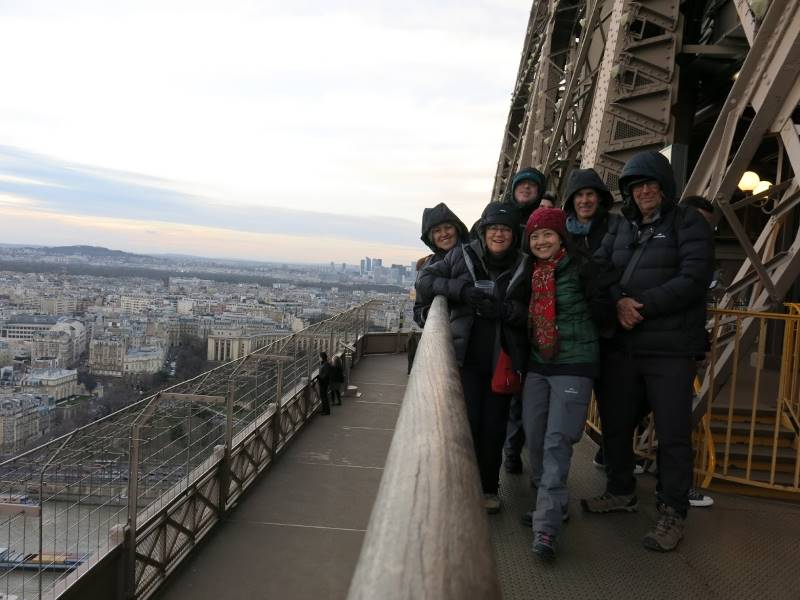 rugged up on the eiffel tower