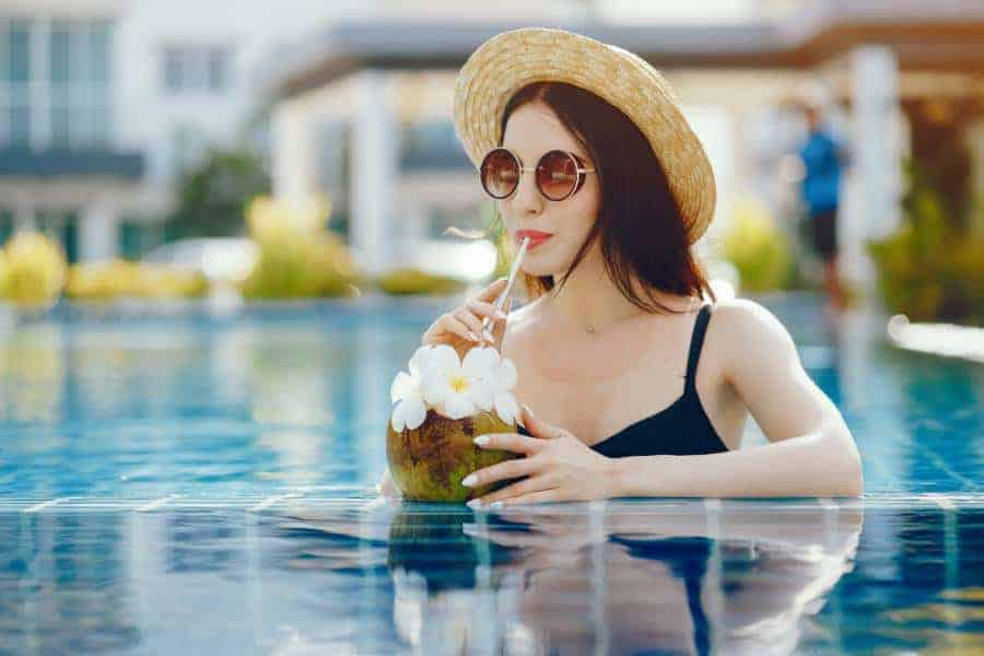 drinking coconut juice by the pool