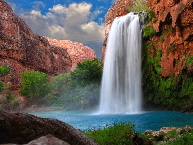 A beautiful waterfall photographed with a slow shutter speed to blur the water