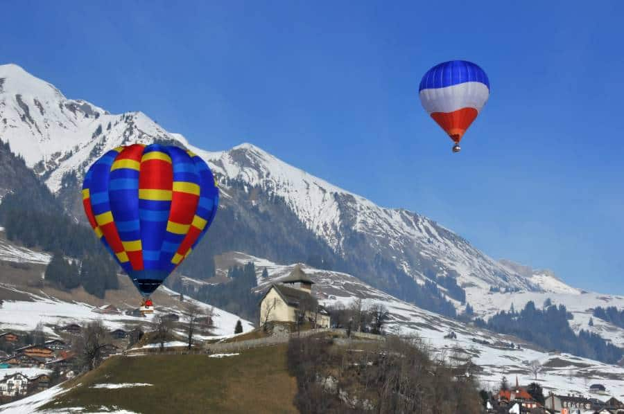 hot air balloons over the swiss alps