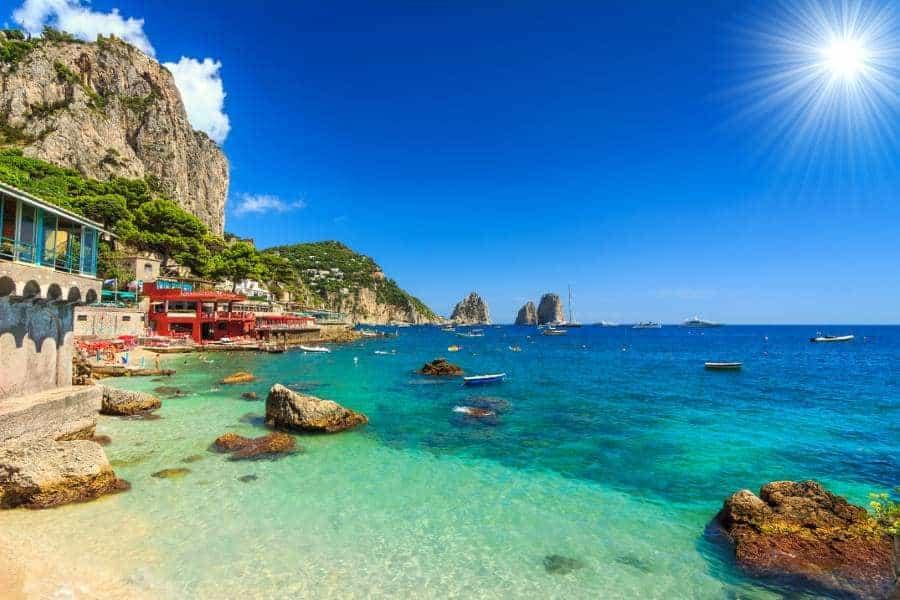 Faraglioni cliffs and wonderful beach in Capri island,Italy