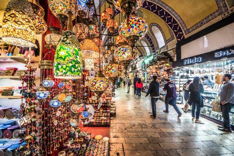 Grand Bazaar for shopping,.Interior of the Grand Bazaar with traditional handmade decorative mosaic multi-colored Turkish lamps for sale hanging on the front side.Istanbul,