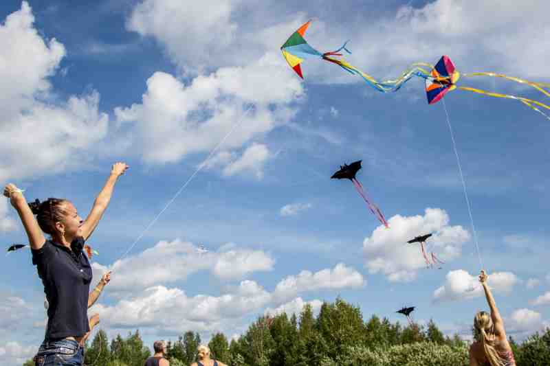 flying a kite with friends