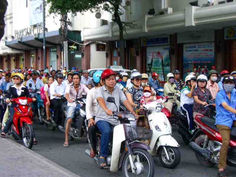 a lot of motor bikes on the street in vietnam
