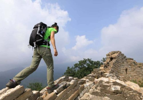 hiker enjoy the view on the top of great wall
