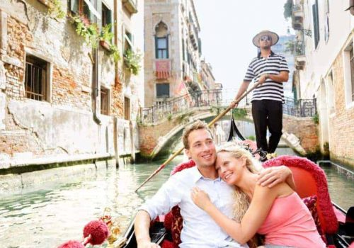 Romantic travel couple in Venice on Gondole ride romance in boat