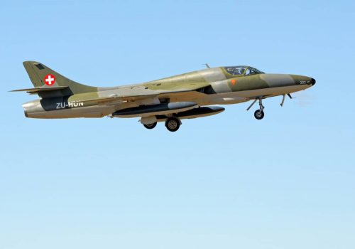 BLOEMFONTEIN, SOUTH AFRICA - MAY 4TH, 2013: A Hawker Hunter T.68 fly-by at an airshow at the Tempe Airport near Bloemfontein, South Africa. It is a subsonic British jet aircraft developed in the 1950s